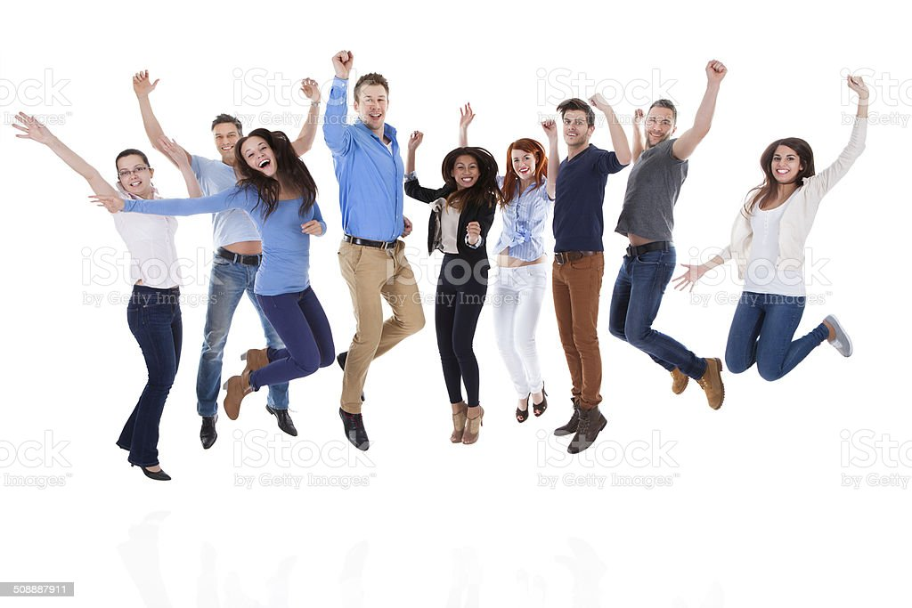 Group of diverse people raising arms and jumping stock photo