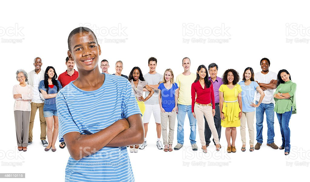 Group of Diverse  People with Young African Boy at front stock photo