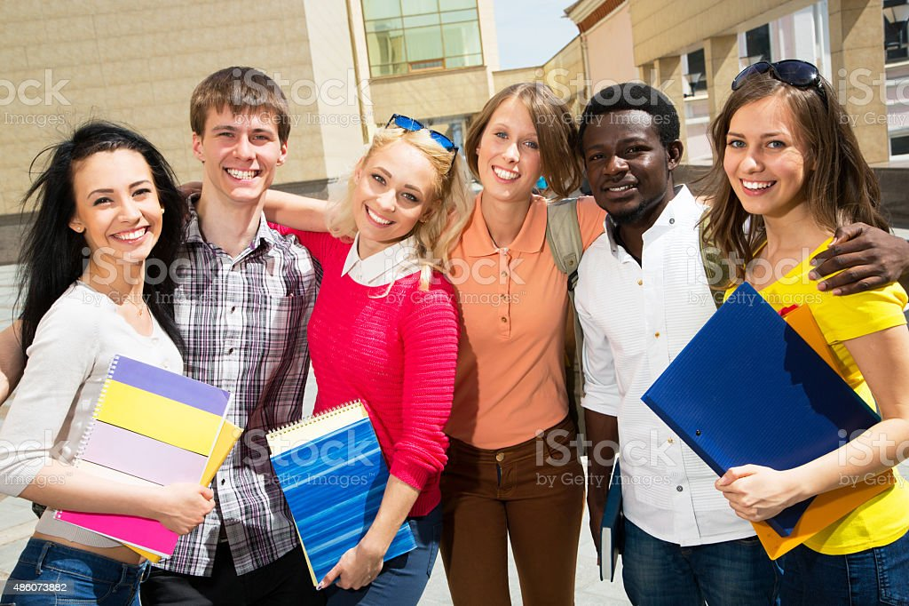 Group of diverse students outside stock photo