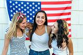 Group of diverse teenage girls celebrating independance day
