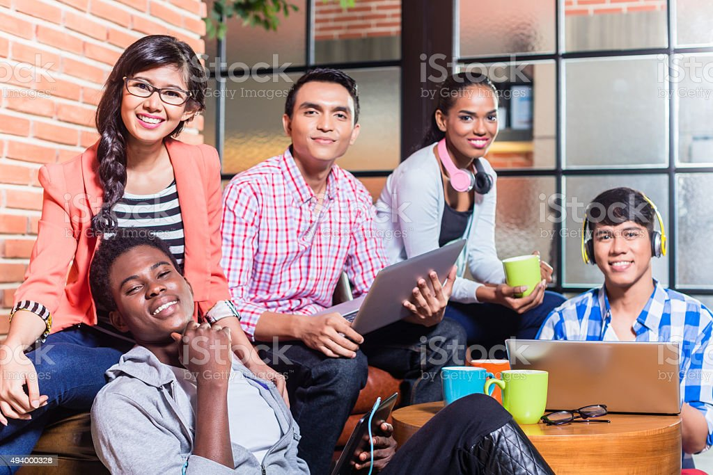 Group of diversity college students learning on campus stock photo