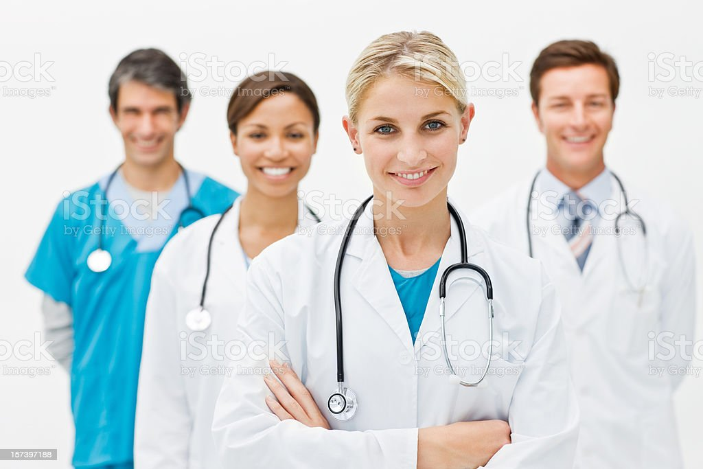 Group of doctors against white background royalty-free stock photo
