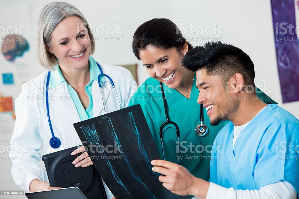 Group of doctors discuss x-ray results stock photo