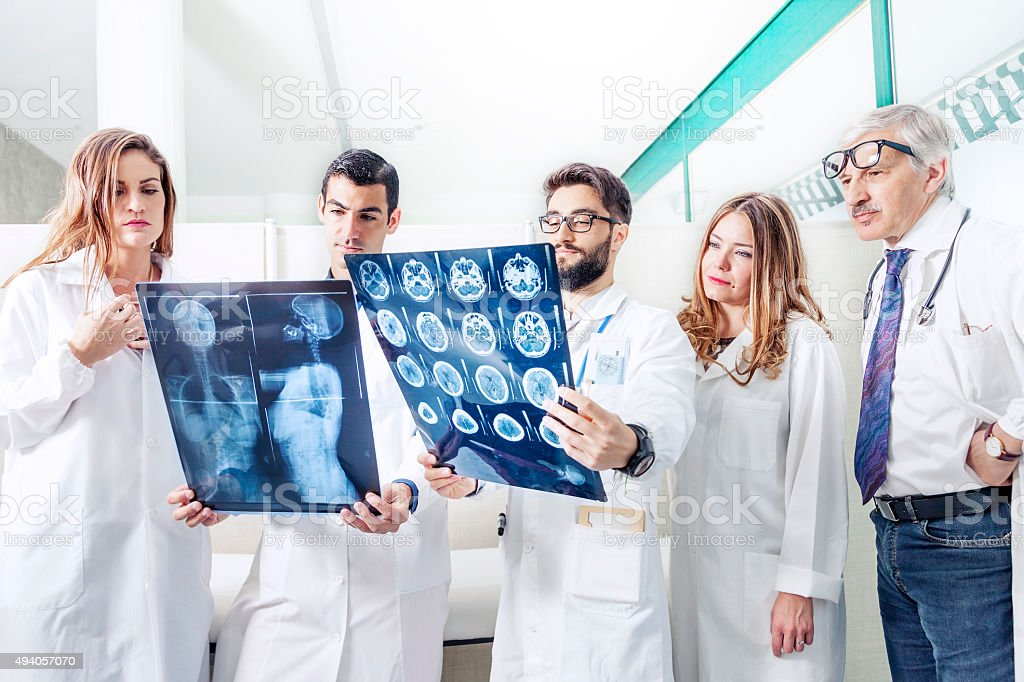 group of doctors examining an x-ray in hospital stock photo