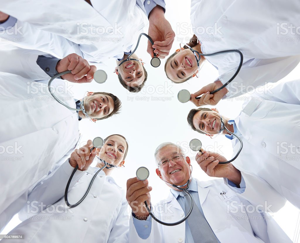 Group of doctors holding stethoscopes. stock photo