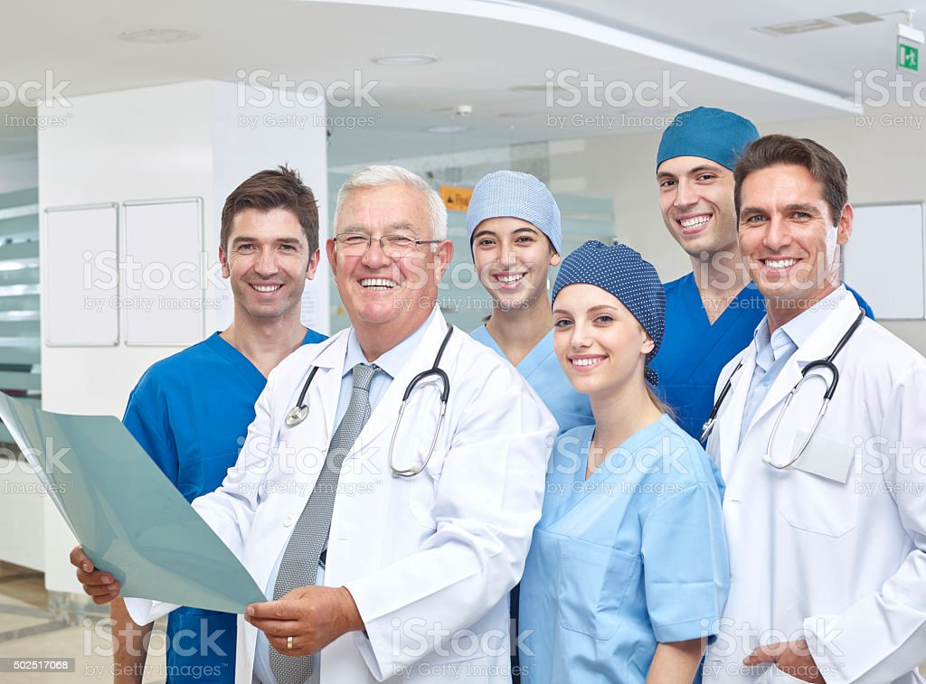 Group of doctors in hospital corridor stock photo