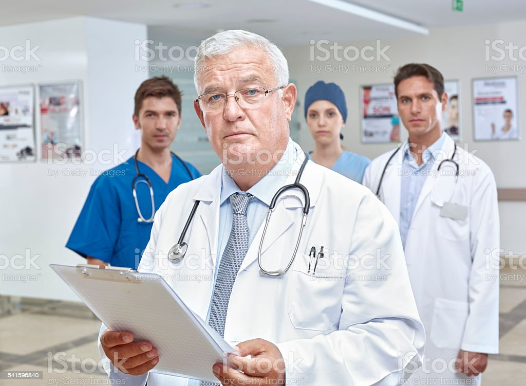 Group of doctors in hospital corridor stock photo