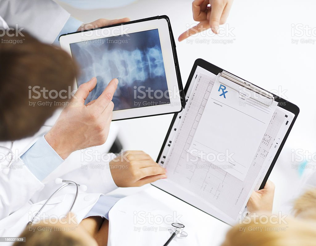 group of doctors looking at x-ray on tablet pc royalty-free stock photo