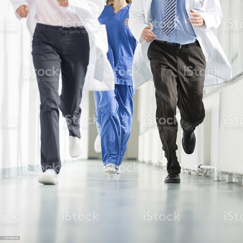 Group of Doctors Running in Corridor royalty-free stock photo