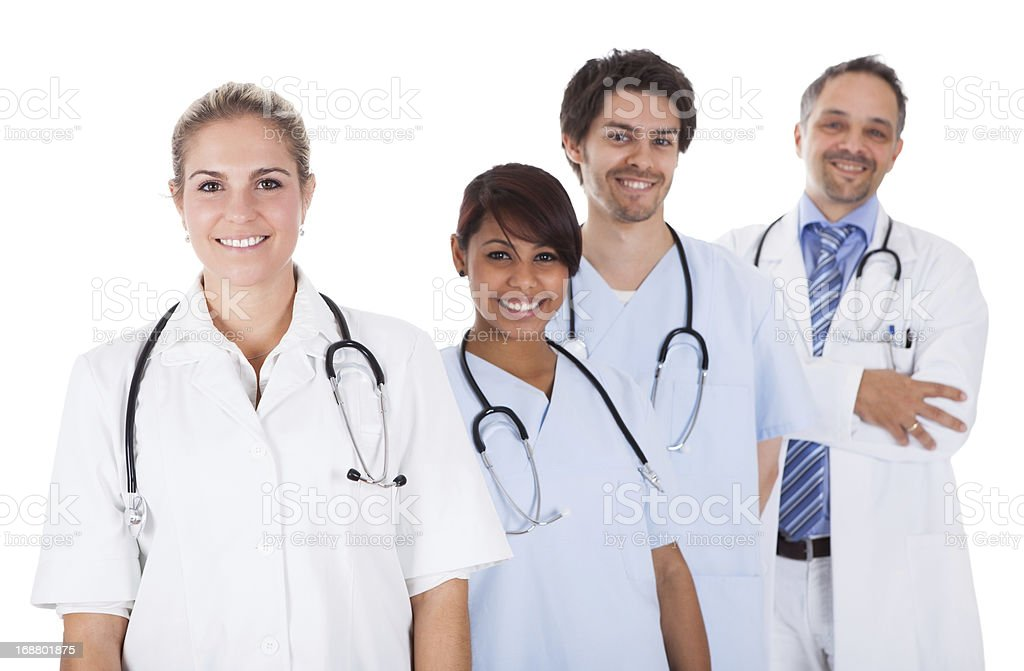 Group of doctors standing together over white stock photo