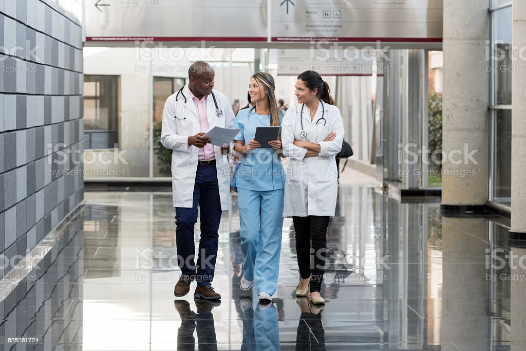 Group of doctors talking at the hospital stock photo