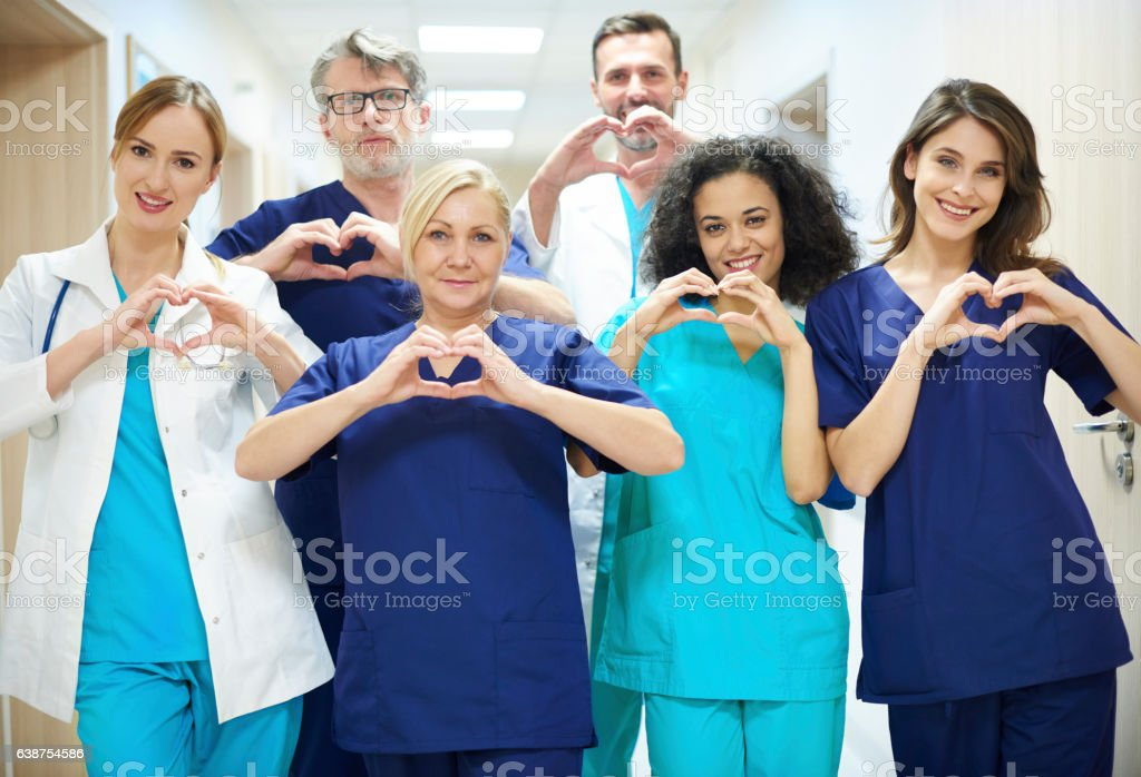 Group of doctors with heart symbol stock photo