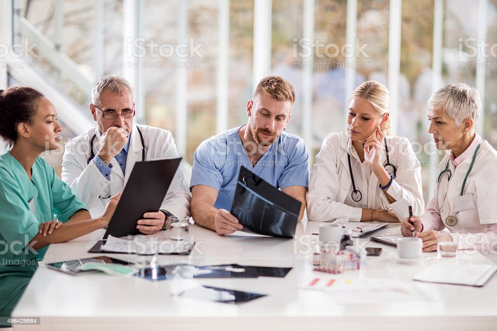 Group of doctors working on a meeting in the office. stock photo