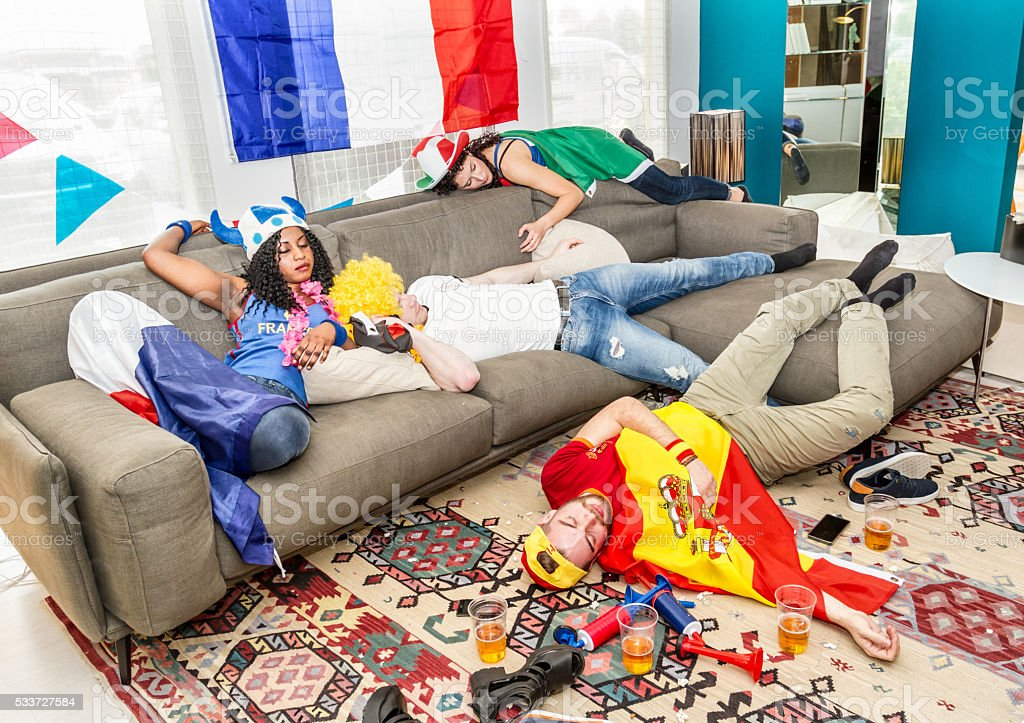 Group of drunk supporters at home stock photo