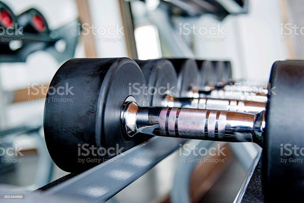 Group of dumbbells stock photo