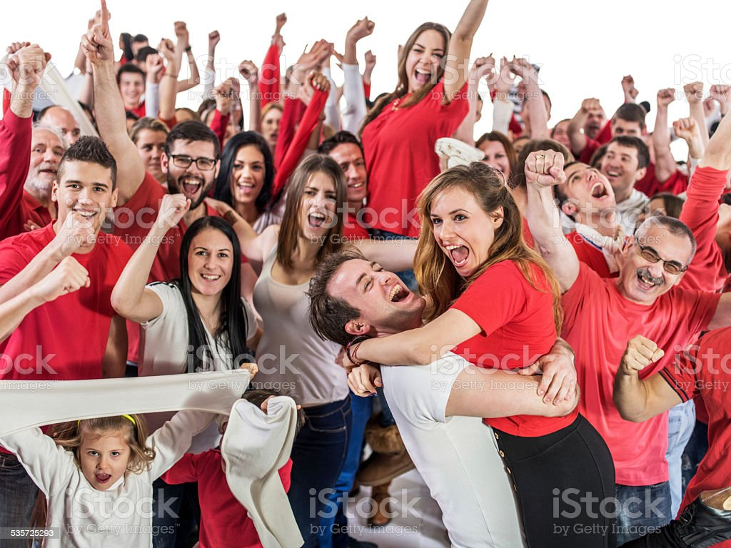 Group of ecstatic fans celebrating. stock photo
