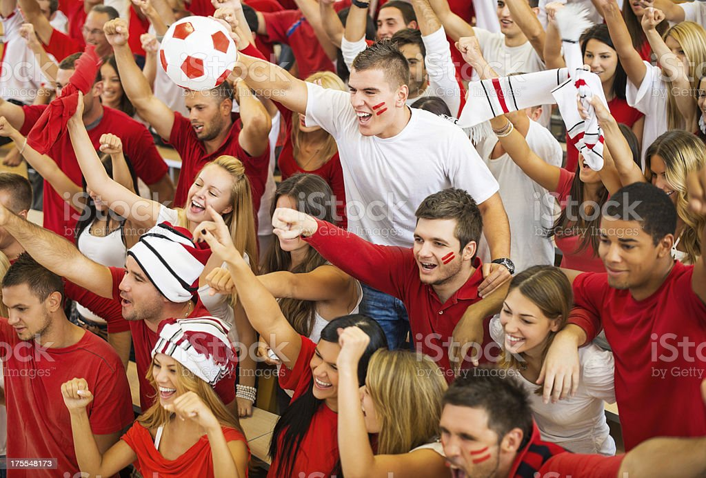 Group of ecstatic football fans cheering. royalty-free stock photo