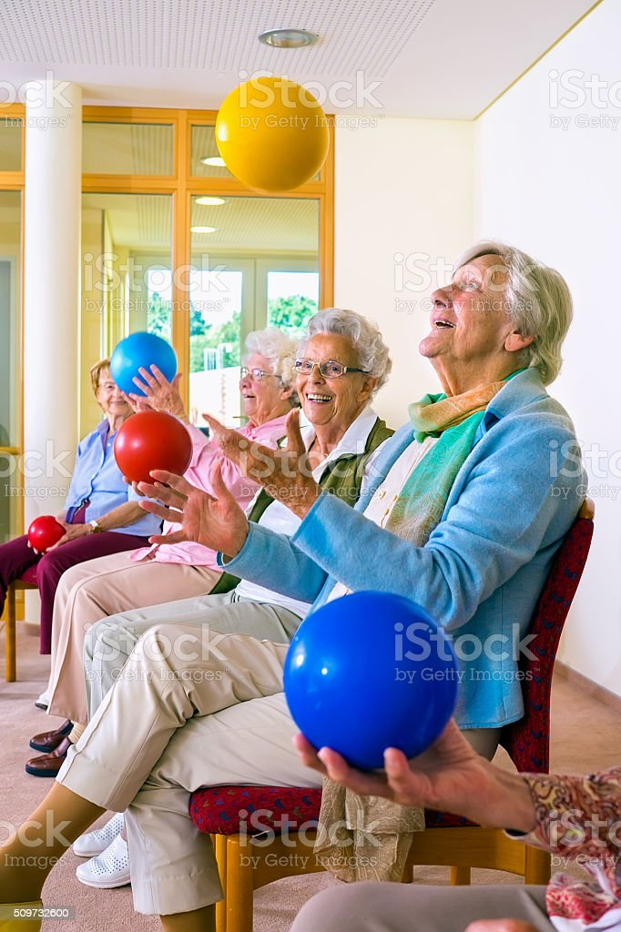Group of elderly ladies in a seniors gym. stock photo