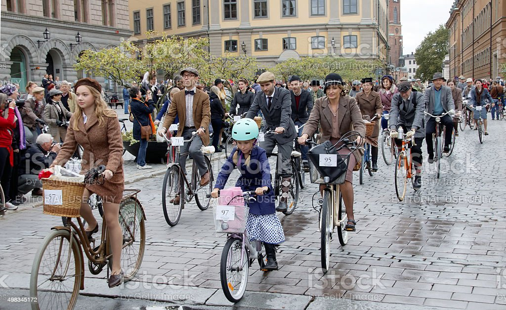 Group of elegant cycling people wearing old fashioned tweed clot stock photo