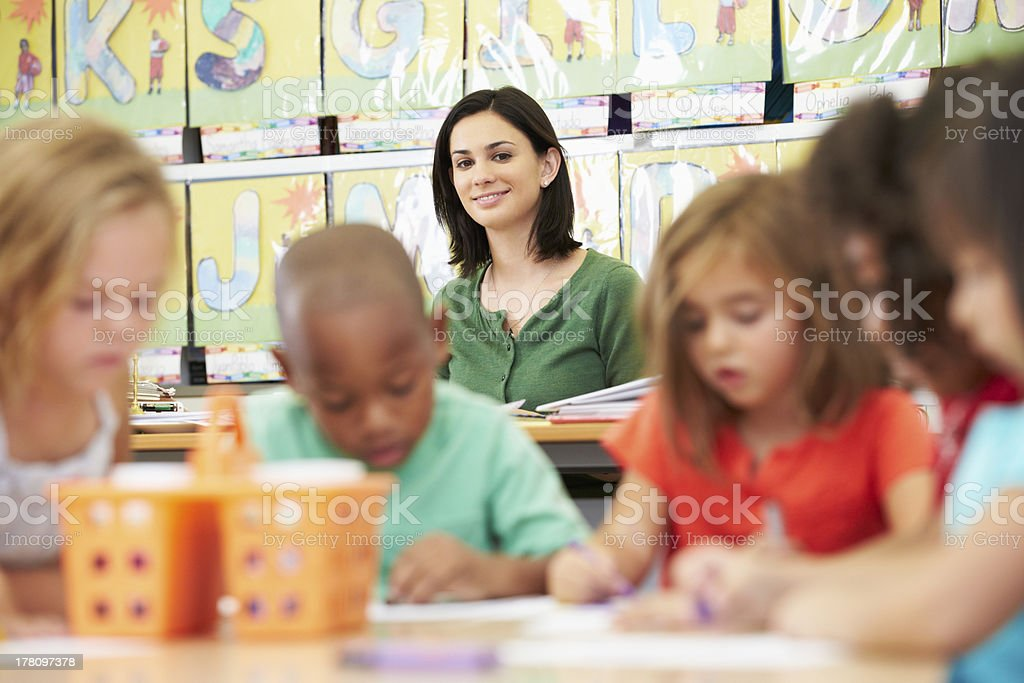 Group Of Elementary Age Children In Art Class With Teacher stock photo