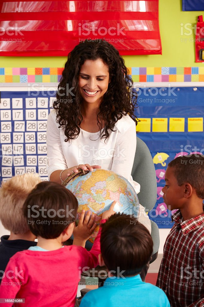 Group Of Elementary Age Schoolchildren In Class With Teacher royalty-free stock photo