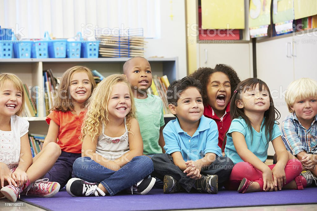 Group of Elementary Pupils In Classroom stock photo