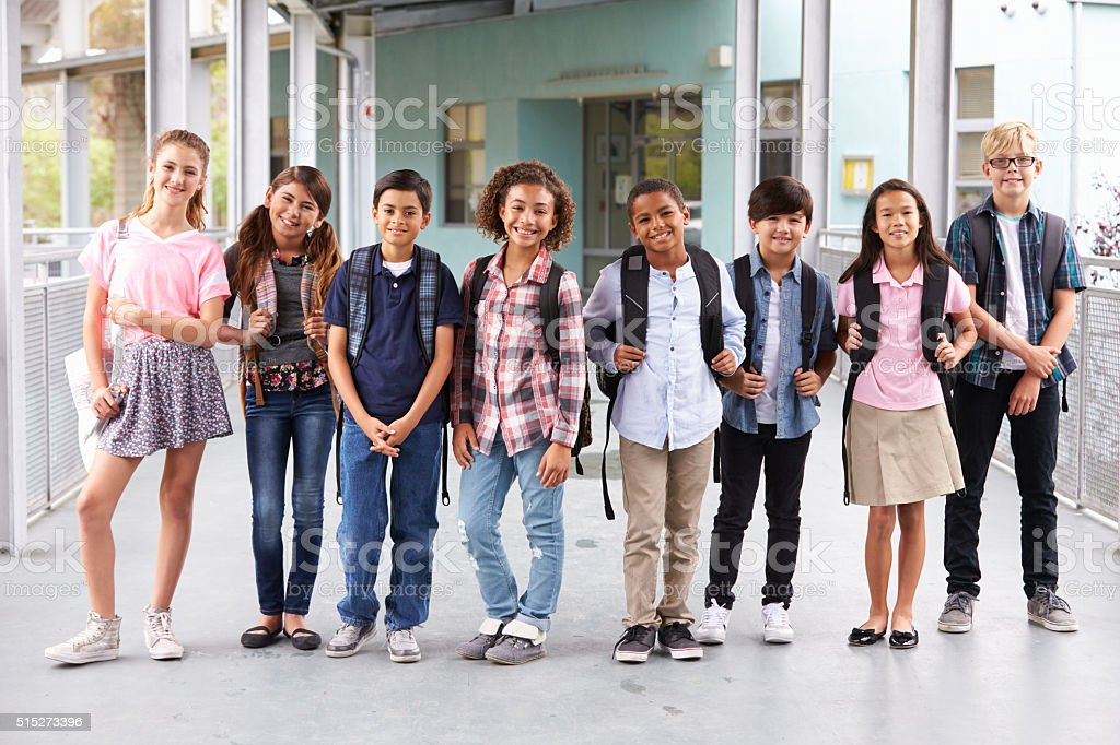 Group of elementary school kids hanging out at school stock photo