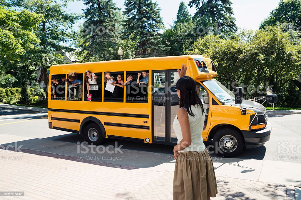 Group of elementary school kids in yellow school bus. stock photo