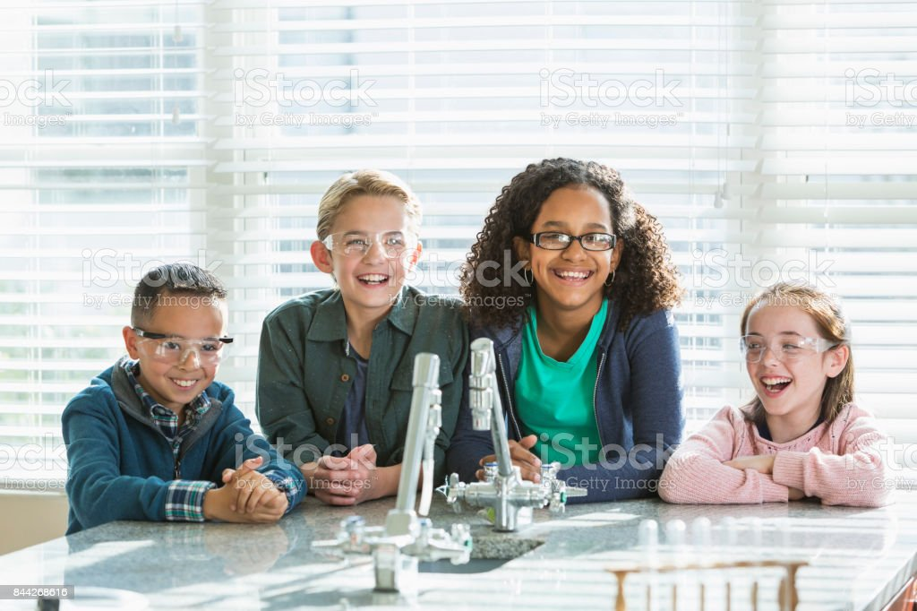 Group of elementary school students in science lab stock photo