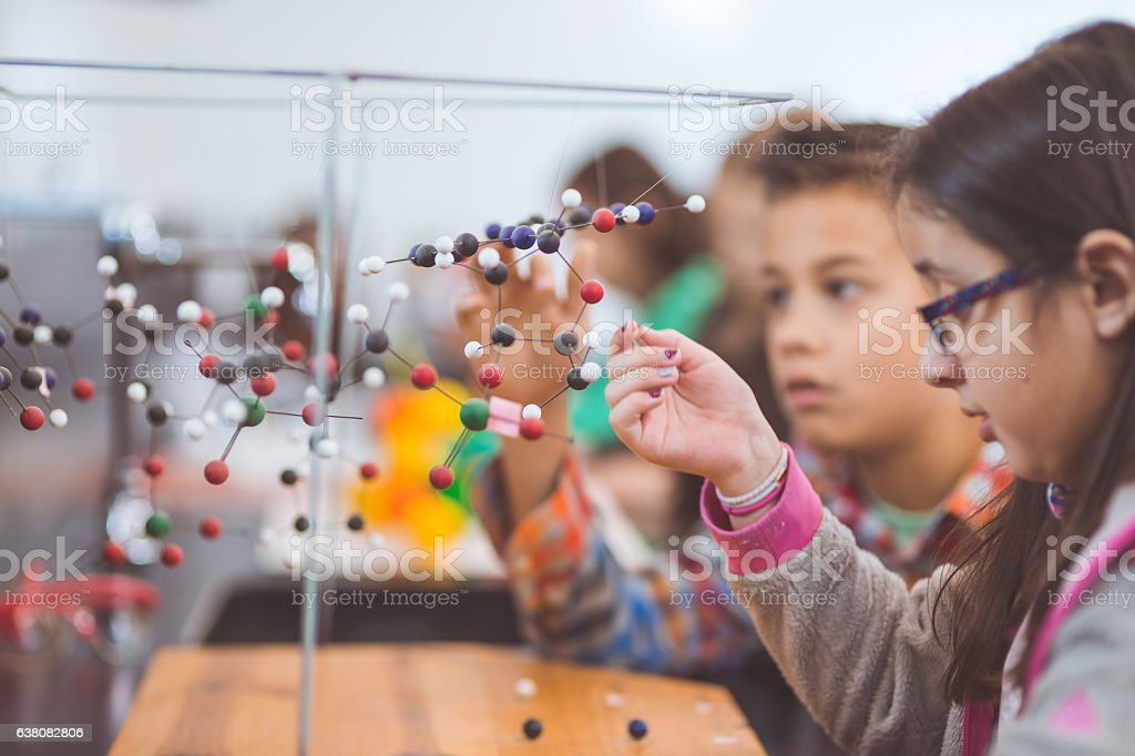 Group of elementary students doing STEM activities in a classroom stock photo