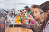 Group of elementary students doing STEM activities in a classroom