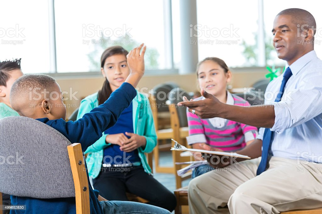 Group of elementary students in tharapy or counseling session stock photo
