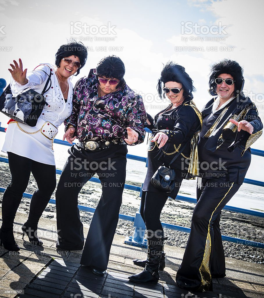 group of elvis impersonaters stock photo