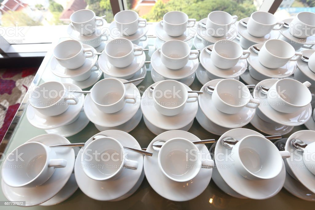 Group of empty coffee cups.Many rows of white cup for service tea or coffee in breakfast or buffet and seminar event. white cup in Catering and Cocktail. stock photo