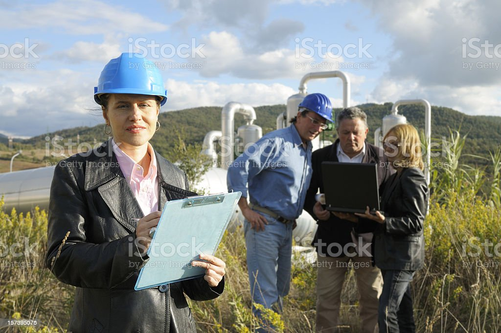 Group of Engineers in a Geothermal Power Station royalty-free stock photo