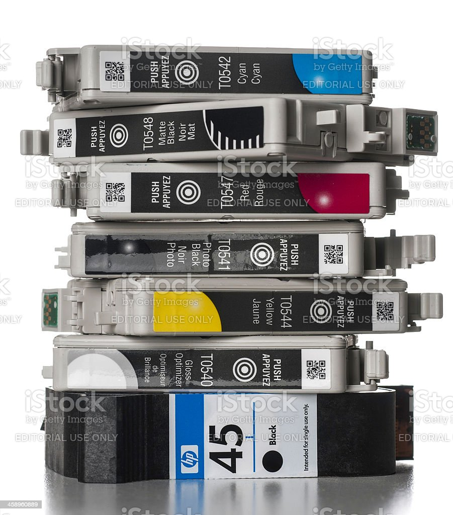 group of Epson and HP printer cartridges stacked stock photo