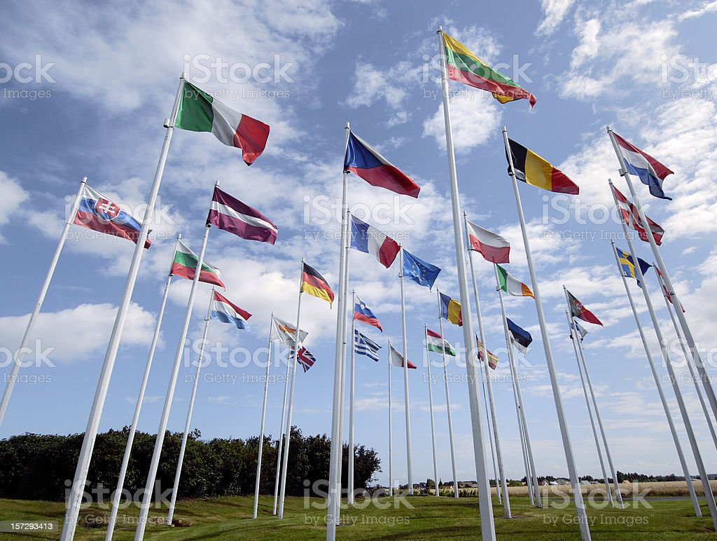Group of European Union flags waving in the wind stock photo