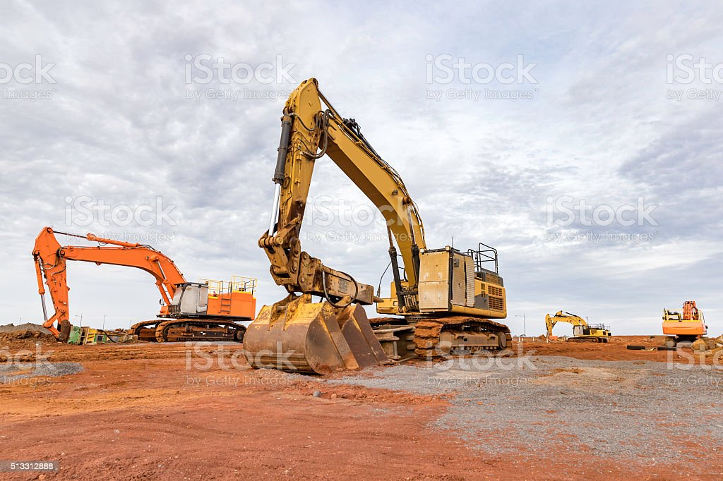 Group of Excavators on a construction worksite stock photo