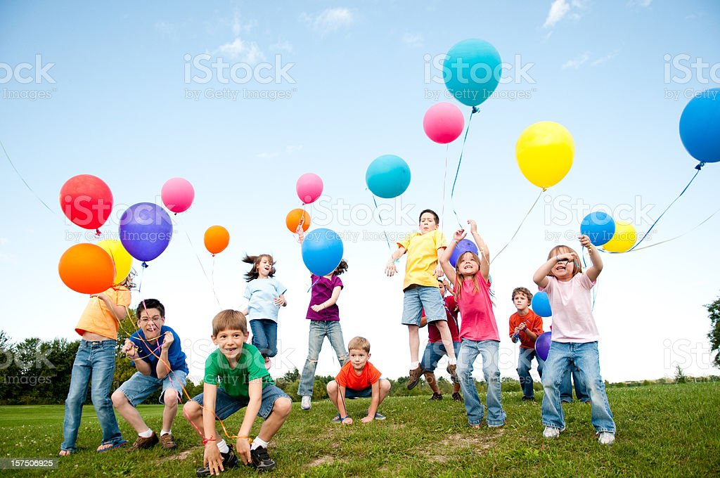 Group of Excited Boys and Girls Celebrating with Balloons royalty-free stock photo