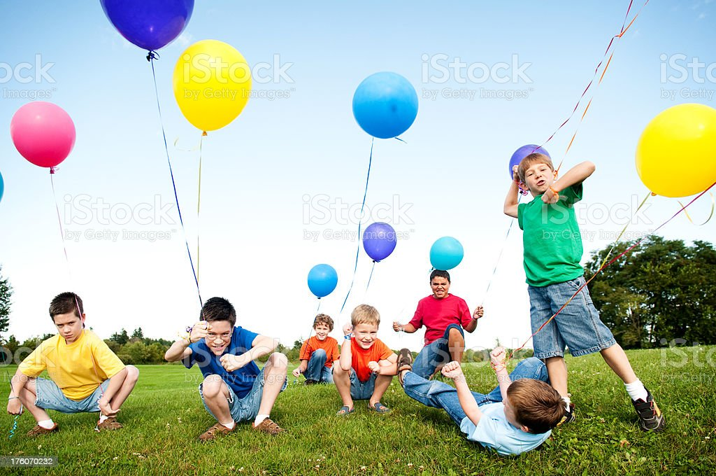 Group of Excited Boys Celebrating Outside royalty-free stock photo