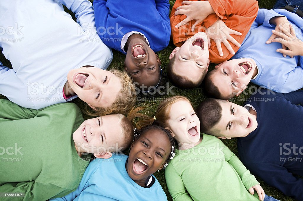 Group of Excited Children Lying in a Circle royalty-free stock photo