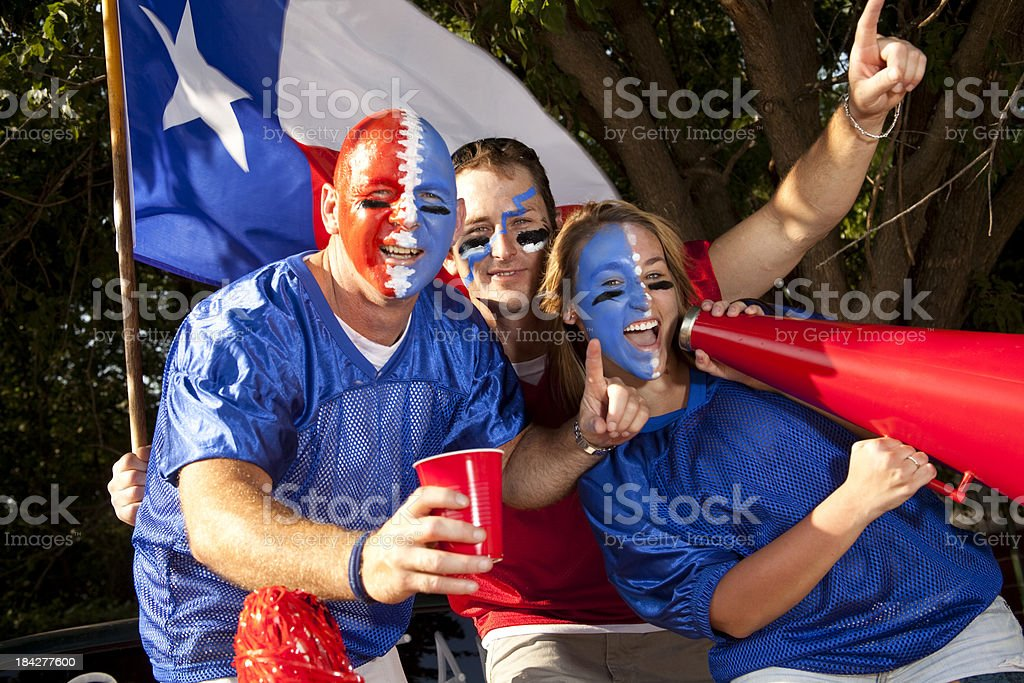 Group of excited football fans yelling at tailgate party. Texas. royalty-free stock photo