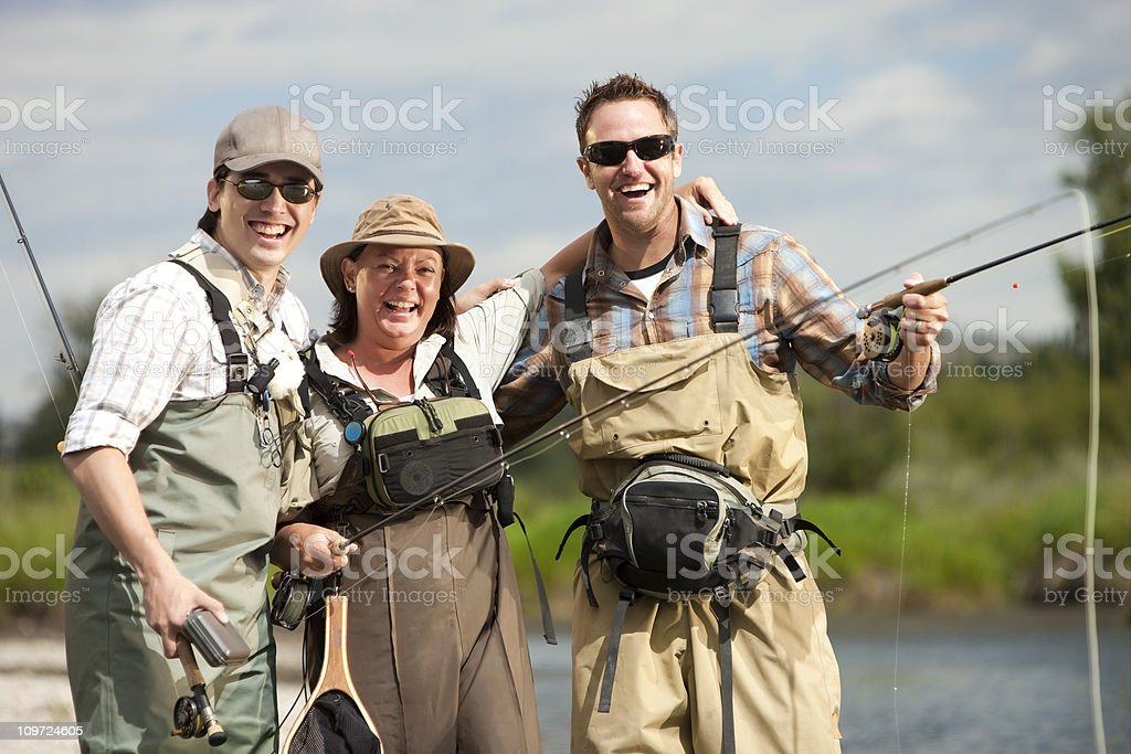 Group of Excited Friends Fishing royalty-free stock photo