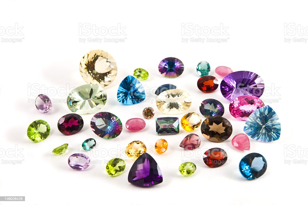 A group of faceted gemstones on a white background royalty-free stock photo