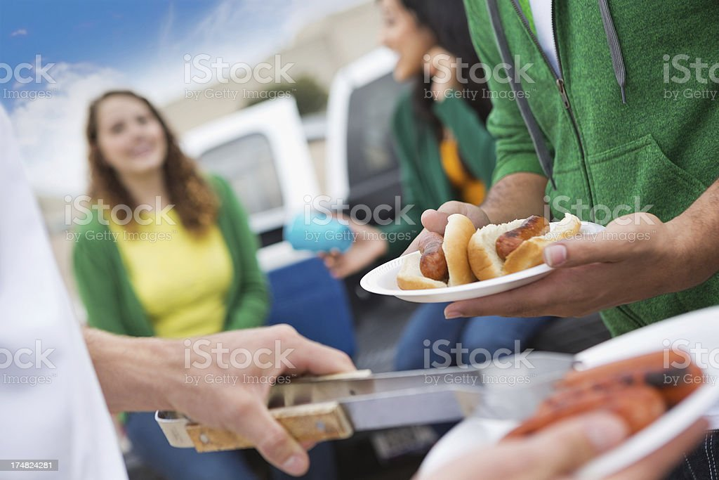Group of fans having tailgating cook out at football stadium stock photo