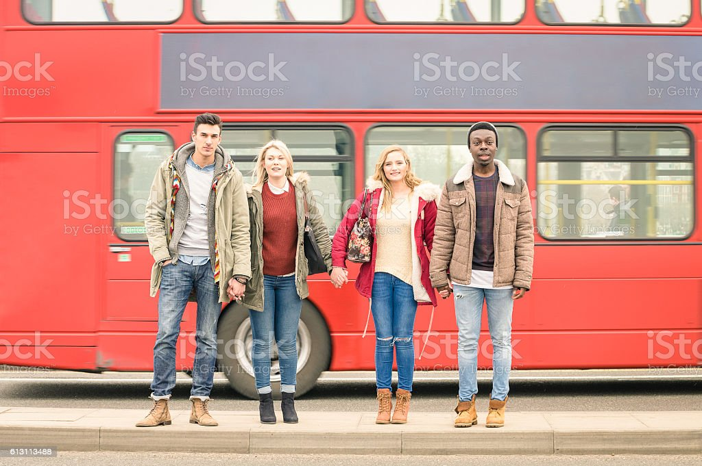 Group of fashion friends crossing the road in London City stock photo