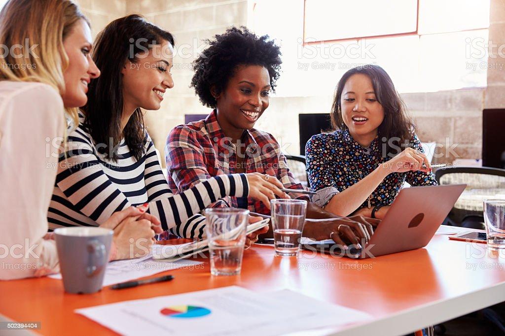 Group Of Female Designers Having Meeting In Modern Office stock photo