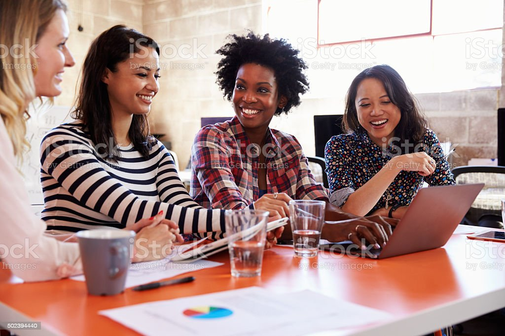 Group Of Female Designers Having Meeting In Modern Office stock photo
