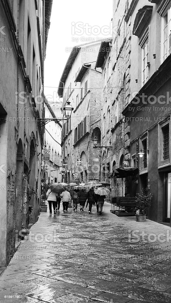 Group of Female Pedestrian in a Rainy Volterra stock photo