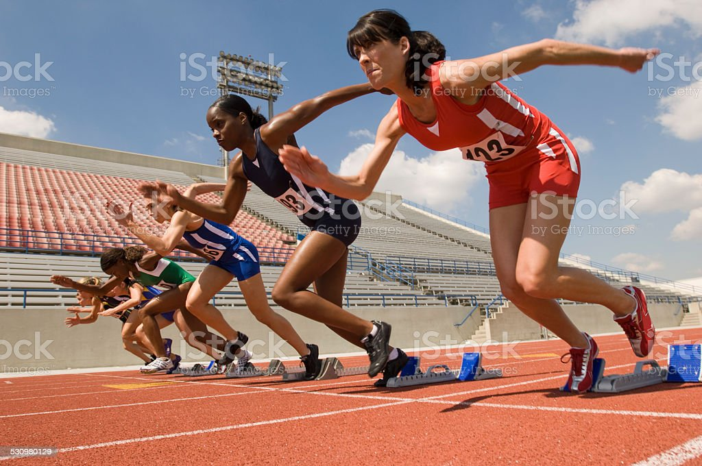 Group of female track athletes stock photo